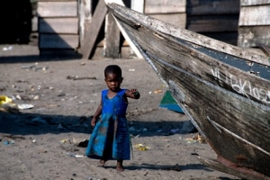 little girl in african fishing community