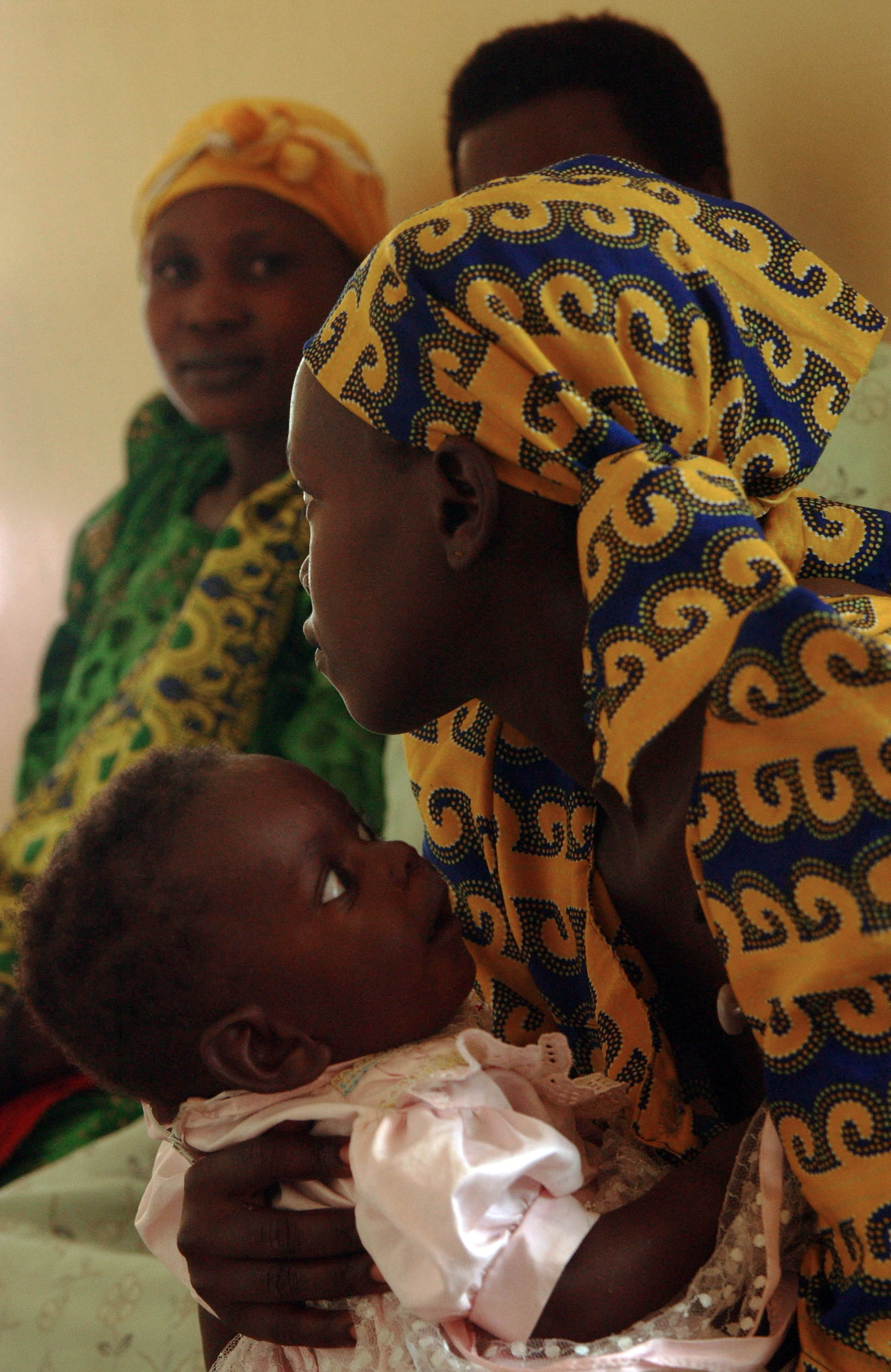 Woman and child at a clinic in Uganda